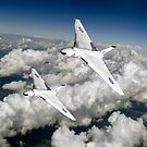 Two Avro Vulcan B1 bombers above clouds by Gary Eason