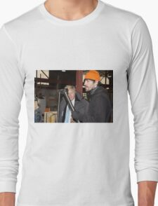 London Mayor,Boris Johnson, tests out London's largest open workshop as he tries welding a bicycle frame with Rob Quirk helping him Long Sleeve T-Shirt