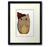 Cat in the red cap Framed Print