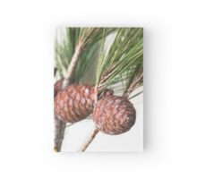 Branch of pine with the pinecones Hardcover Journal