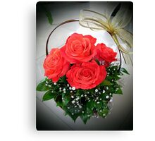 Basket with red roses Canvas Print