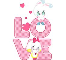 Two cute bunnies on a background of the word LOVE Photographic Print