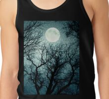 Dark enchanted photo of a full moon in the trees branches background. Blue fairy-tale colors Tank Top