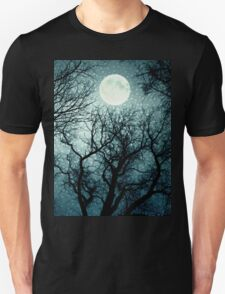 Dark enchanted photo of a full moon in the trees branches background. Blue fairy-tale colors Unisex T-Shirt