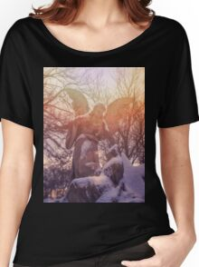 Angel statue illuminated by sunlight. Cemetery during the winter Women's Relaxed Fit T-Shirt