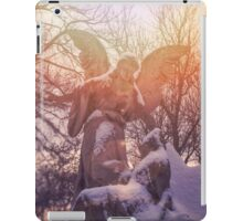 Angel statue illuminated by sunlight. Cemetery during the winter iPad Case/Skin