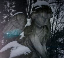 Angel statue illuminated by moonlight. Cemetery during the winter Sticker