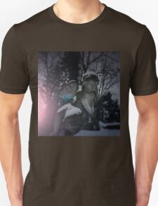 Angel statue illuminated by moonlight. Cemetery during the winter Unisex T-Shirt