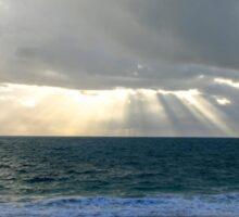 Sun shining through clouds at beach Sticker