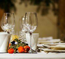 Wineglasses ready for the dinner in little restaurant, France by Alexander Sorokopud
