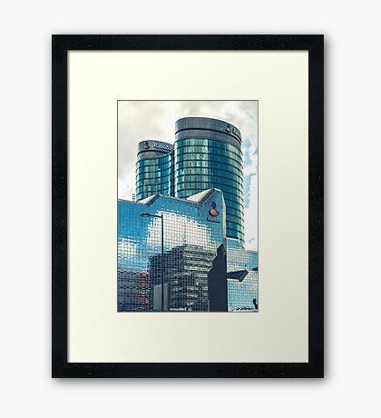 Mirroring office buildings Framed Print