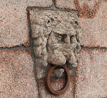 granite lion's head with an iron ring  by mrivserg