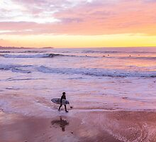Surfer at sunset, Watergate Bay, Cornwall, UK by Zoe Power