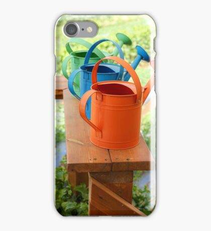 Watering cans at a small Organic vegetable patch  iPhone Case/Skin