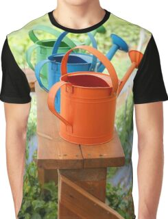 Watering cans at a small Organic vegetable patch  Graphic T-Shirt