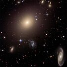 Giant Elliptical Galaxy and its Host Galaxy Cluster. by StocktrekImages