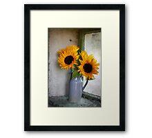 Sunflowers in a stone jar on a farmhouse window Framed Print