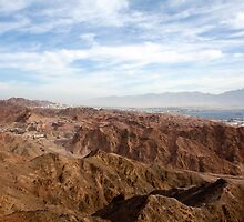 The colourful Eilat mountain range The gulf of Aqaba in the background  by PhotoStock-Isra