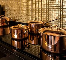 Copper pans on the stove by mrivserg