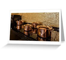 Copper pans on the stove Greeting Card