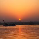 Sunrise over the river Ganges. by John Dalkin