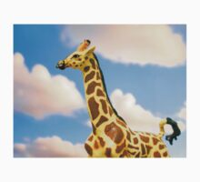 Toy giraffe on cloudy sky background  Kids Tee