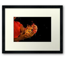 African model with a ball of fire in her hands.  Framed Print