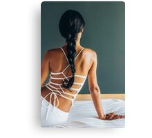 Beautiful Elegant Young Woman Sitting on Bed From Behind Canvas Print