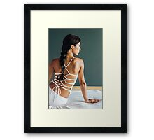 Profile of Attractive Young Woman Sitting on Bed Framed Print