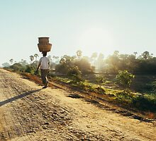 Woman Carrying Baskets on Head Walking in Burmese Countryside in Early Morning by visualspectrum