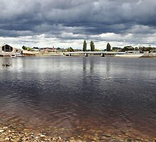 stormy clouds at Ulverstone's Leven River by gaylene