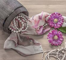Still life details, scarf and pearls in retro vintage wooden box by JPopov