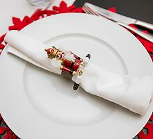 Christmas dinner table set and decorated with red and green  by PhotoStock-Isra