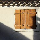 Shutters and shadows. by Paul Pasco