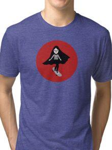 A girl walks home alone at night. Tri-blend T-Shirt