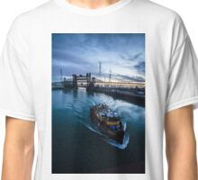 Yellow tug boat passing by  Classic T-Shirt