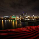Chicago Skyline at night with red ribbon of light  by Sven Brogren