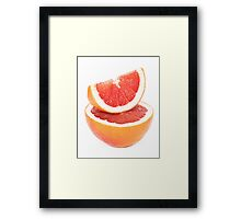 Sliced grapefruit on white background Framed Print