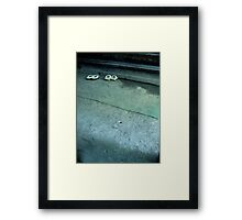 Please leave your shoes at the door... Framed Print