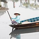 Woman on a boat by SUBI