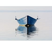Bow of the boat is reflected in the water Photographic Print