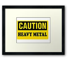 CAUTION HEAVY METAL Framed Print