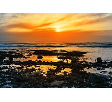 deep orange reflections at rocky beal beach Photographic Print