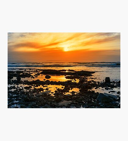 deep orange reflections at rocky beal beach Photographic Print