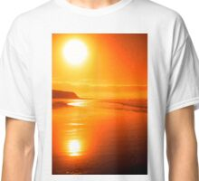distant cliffs on a sunsey beach Classic T-Shirt