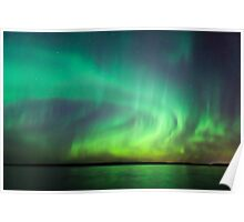 Northern lights over lake in Finland Poster