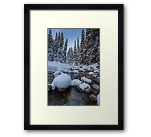 Snowy river with pine trees Framed Print
