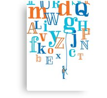 Man holding a floating letter from flying alphabet Canvas Print