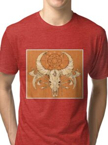 image of a skull with axes and spears tattoo style in color   Tri-blend T-Shirt