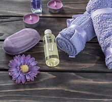 Spa concept. Lavender oil, flowers bath  and purple towels by JPopov